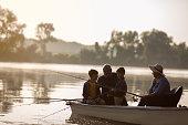 Grandparents and grandchildren fishing in the boat