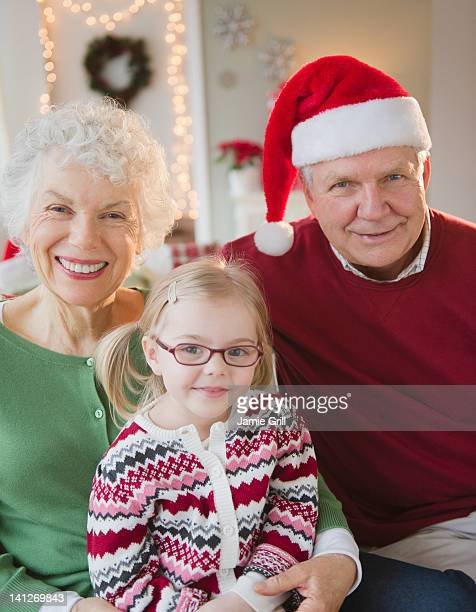 Grandparents and granddaughter at Christmas