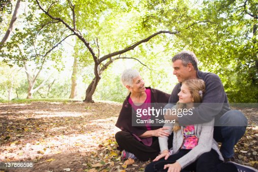 Grandparents and granddaughter in park : Stock Photo