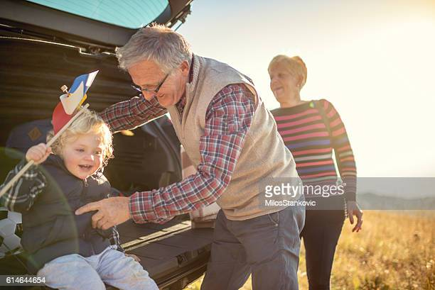 Grandparents and grandson outdoors