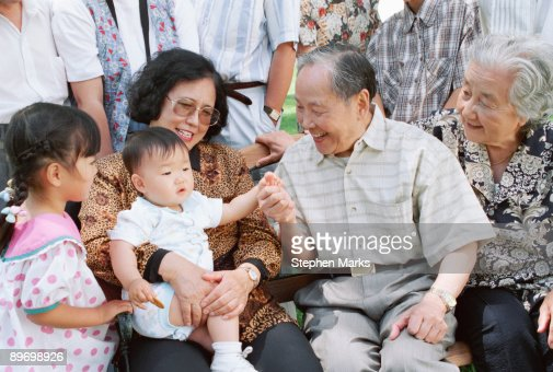 Grandparents and mother playing with baby : Stock Photo