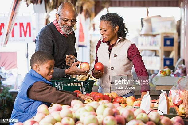 Grandparents and their grandson choosing apples
