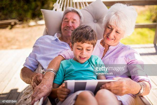Grandparents and their grandson using a digital tablet