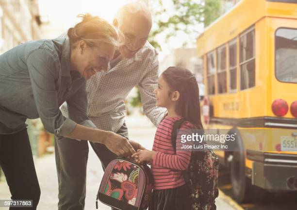 Grandparents bringing granddaughter to school bus