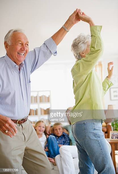 Grandparents dancing in front of family