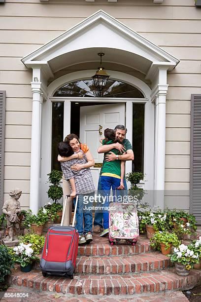 Grandparents embracing grandchildren