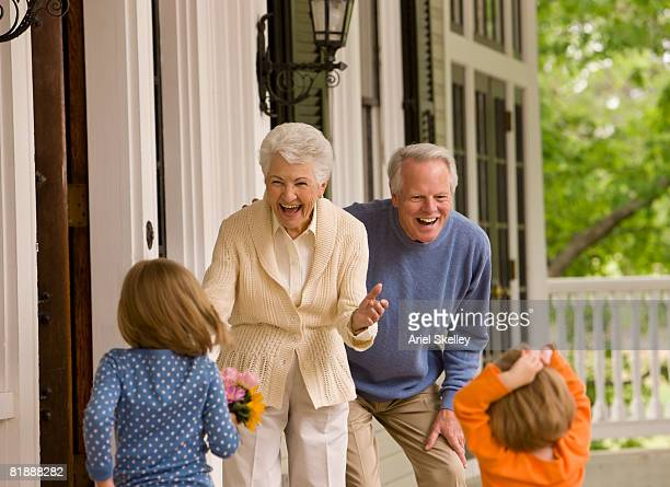 Grandparents Greeting Kids at Front Door