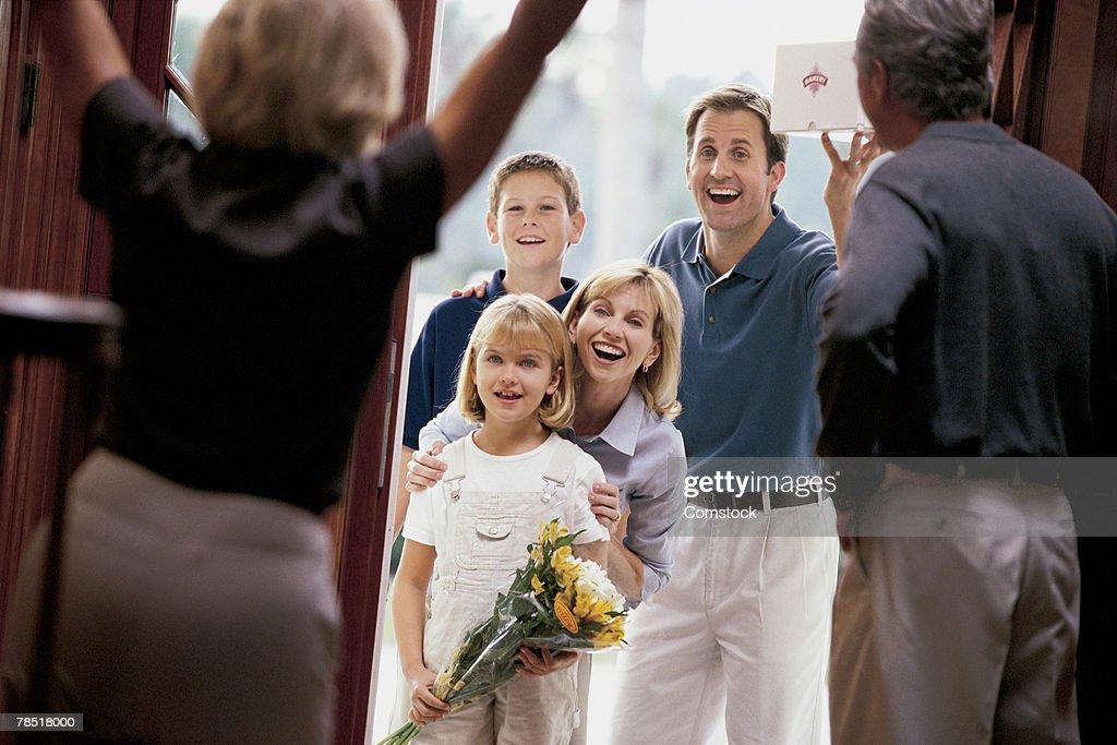 Grandparents greeting visiting family