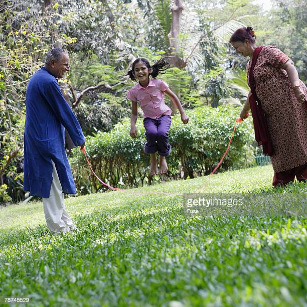 Grandparents Jumping Rope with Girl