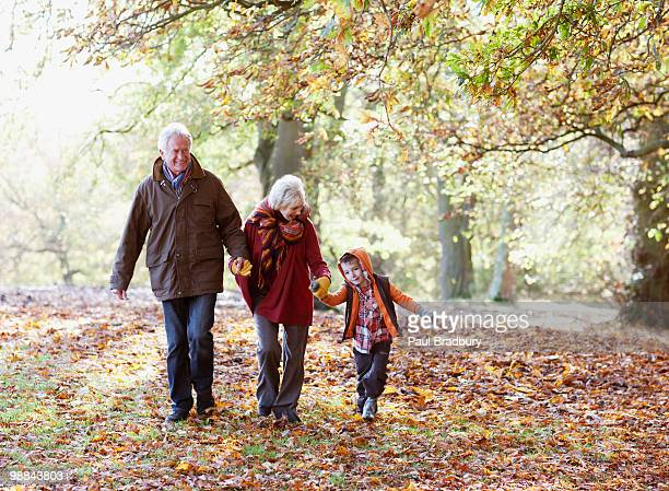 Grandparents playing in park with grandson