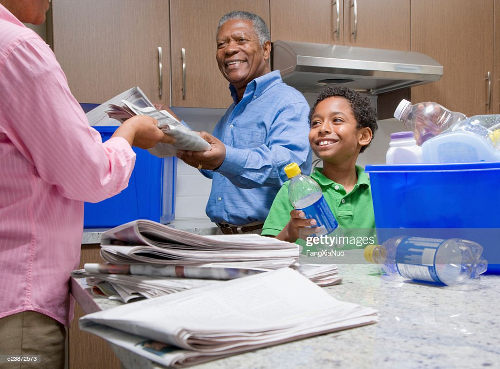 Grandparents Recycling With Grandson in Kitchen : Stock Photo