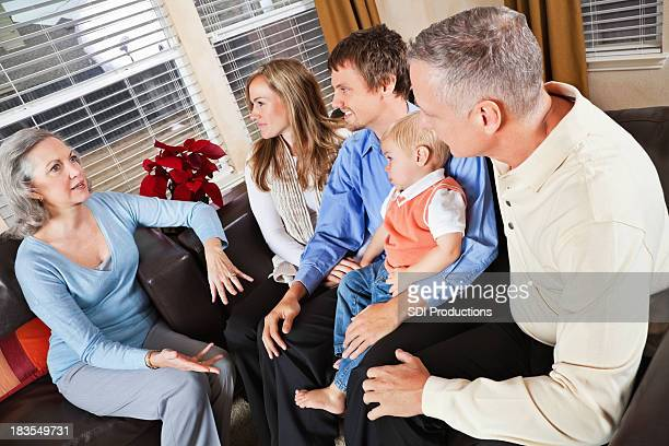Grandparents Talking to Children's Family in Living Room