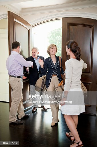Grandparents visiting adult children : Stock Photo