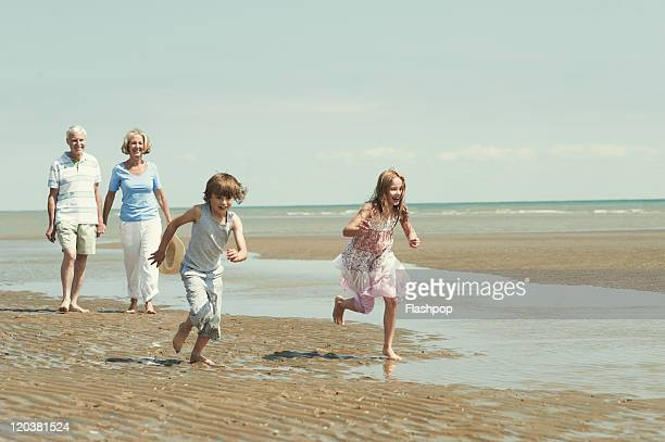 Grandparents with grandchildren at the beach