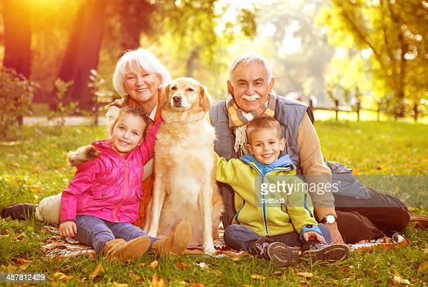 Grandparents with grandchildren in park.