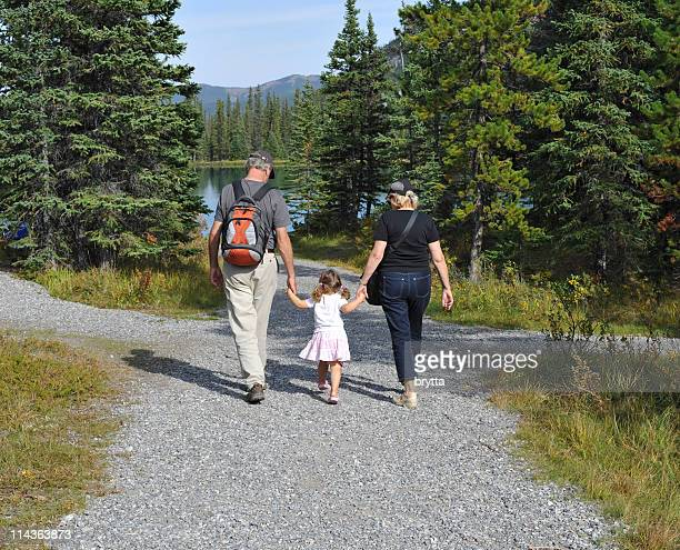 Grandparents with granddaughter near Forget-Me-Not Lake , Alberta,Canada