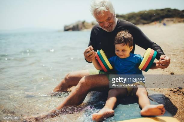 Grandpa's teaching me how to surf