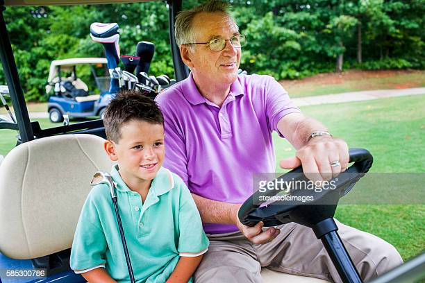 Grandson and Grandfather Playing Golf