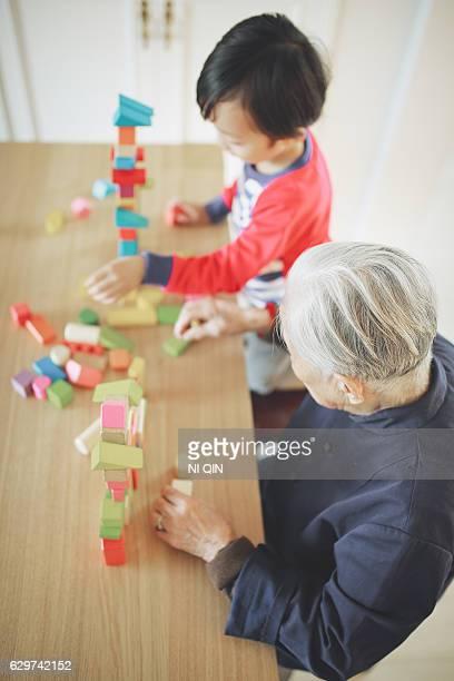 Grandson and grandma playing with blocks