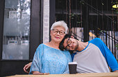 A cute picture of grandson and grandmother portrait taken at the outside of restaurant