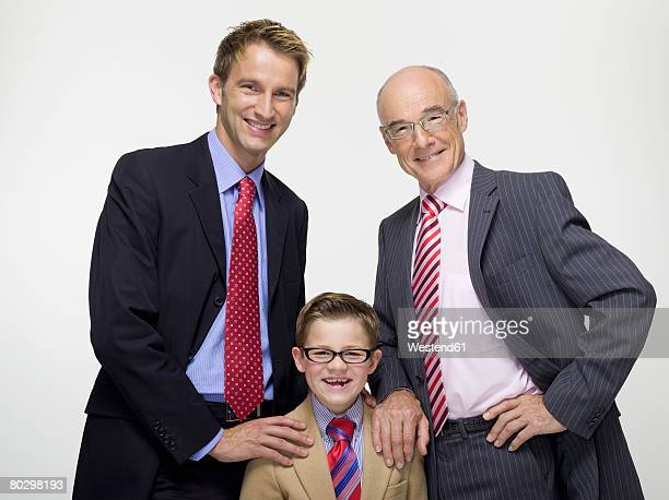 Boy (8-11), father and grandfather smiling, portrait, close-up