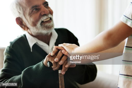 Grandson holding grandpa's hands : Stock Photo
