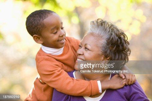 Grandson hugging grandmother : Stock Photo