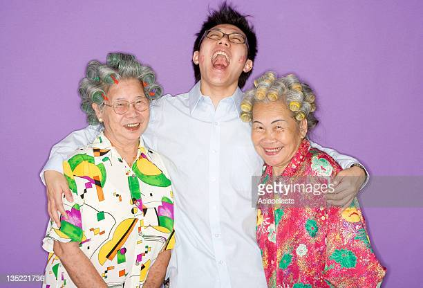 Grandson hugging grandmothers.