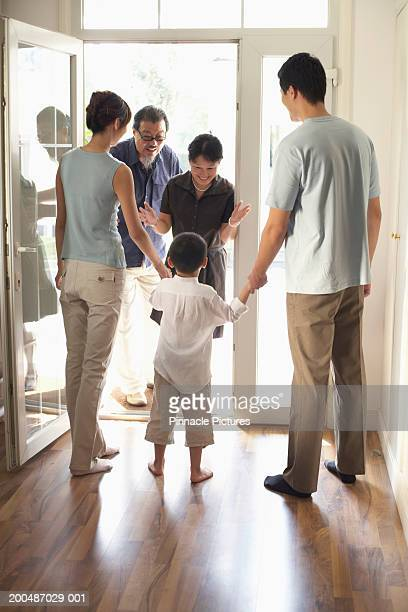 Grandson (4-5) meeting grandparents at door