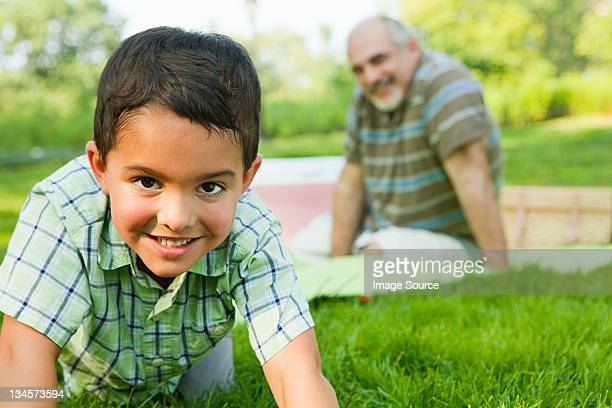 Grandson smiling in park, portrait