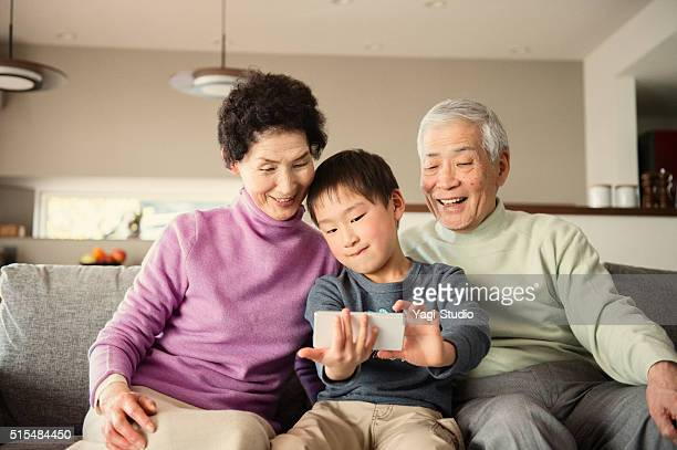 Grandson taking a family photo with smartphone