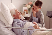 Grandson visiting Grandfather in hospital