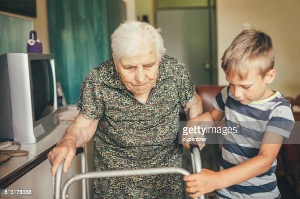 Grandson visiting his granny in nursery