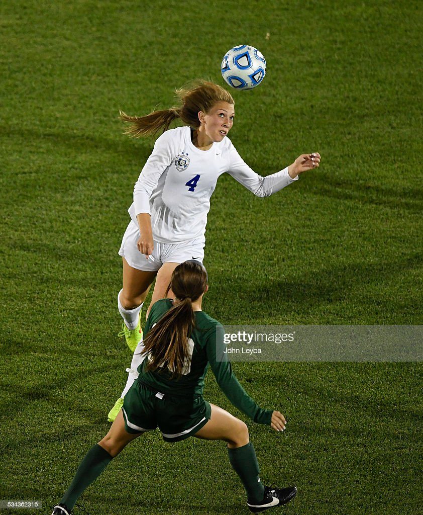 Grandview Wolves d Jessica Hixson (4) heads the ball away from Mountain Vista Golden Eagles forw Mia Bonifazi (20) in the second half during the 5A state soccer championship May 25, 2016 at Dicks Sporting Goods Park. Grandview Wolves defeated Mountain Vista Golden Eagles 2-1for the title.