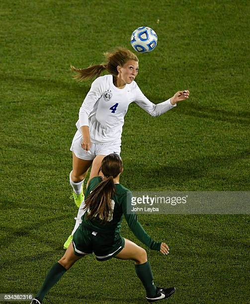 Grandview Wolves d Jessica Hixson heads the ball away from Mountain Vista Golden Eagles forw Mia Bonifazi in the second half during the 5A state...