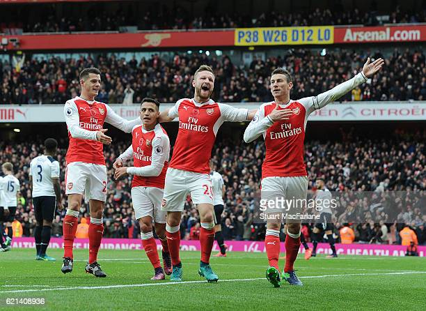 Granit Xhaka Alexis Sanchez Shkodran Mustafi and Laurent Koscielny celebrate the Arsenal goal during the Premier League match between Arsenal and...