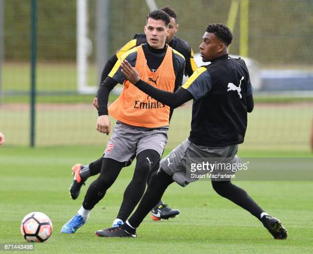 Granit Xhaka and Alex Iwobi of Arsenal during a training session at London Colney on April 22 2017 in St Albans England