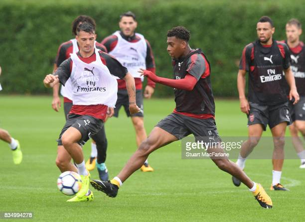 Granit Xhaka and Alex Iwobi of Arsenal during a training session at London Colney on August 18 2017 in St Albans England