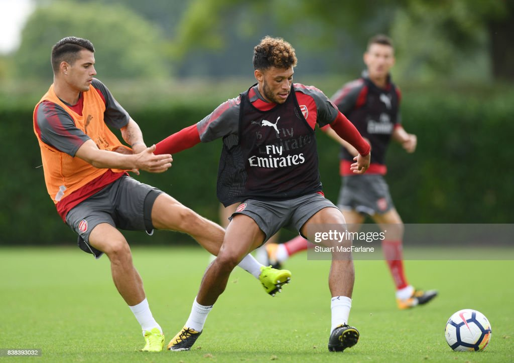 Granit Xhaka and Alex Oxlade-Chamberlain of Arsenal during a training session at London Colney on August 24, 2017 in St Albans, England.