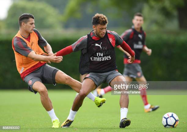 Granit Xhaka and Alex OxladeChamberlain of Arsenal during a training session at London Colney on August 24 2017 in St Albans England