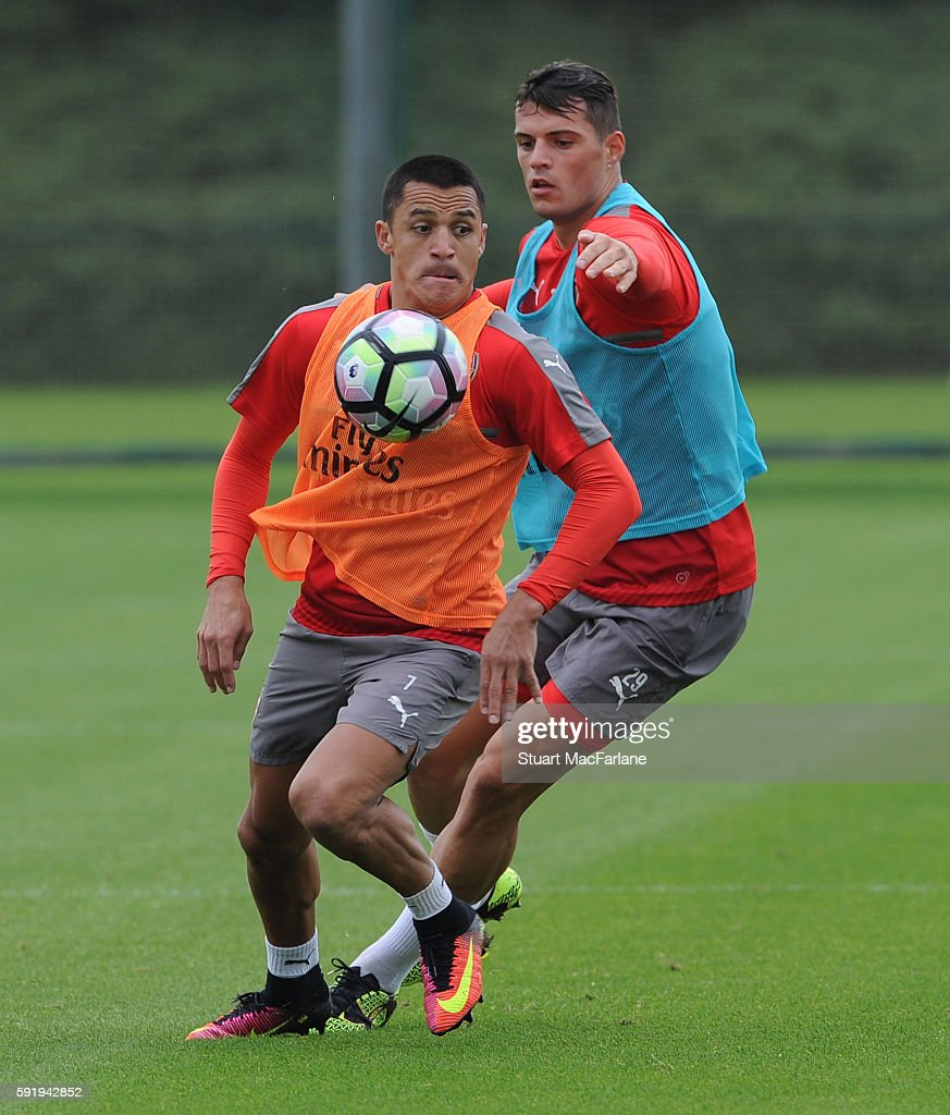 Granit Xhaka and Alexis Sanchez of Arsenal during a training session at London Colney on August 19 2016 in St Albans England
