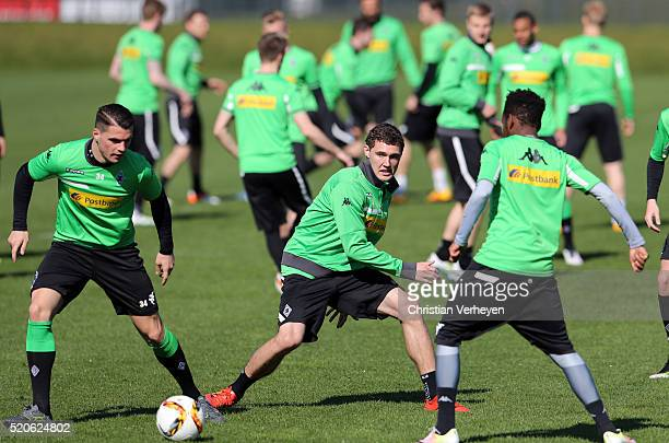 Granit Xhaka and Andreas Christensen battle for the ball during a Training Session of Borussia Moenchengladbach at BorussiaPark on April 12 2016 in...