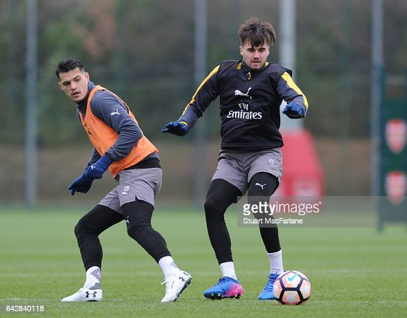 Granit Xhaka and Carl Jenkinson of Arsenal during a training session on February 19 2017 in St Albans England
