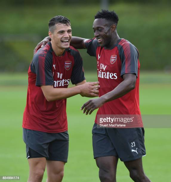 Granit Xhaka and Danny Welbeck of Arsenal during a training session at London Colney on August 18 2017 in St Albans England