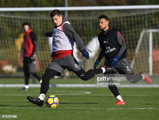 Granit Xhaka and Francis Coquelin of Arsenal during a training session at London Colney on November 17 2017 in St Albans England