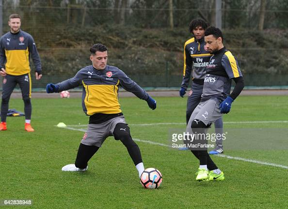 Granit Xhaka and Francis Coquelin of Arsenal during a training session on February 19 2017 in St Albans England