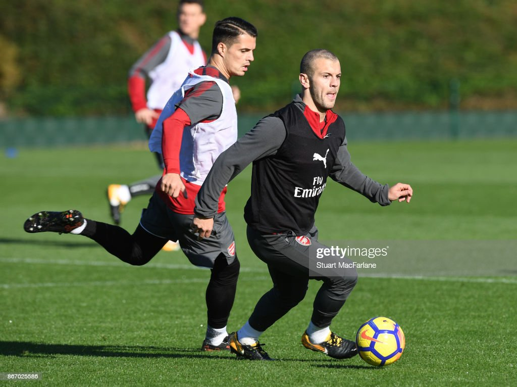 Granit Xhaka and Jack Wilshere of Arsenal during a training session at London Colney on October 27, 2017 in St Albans, England.