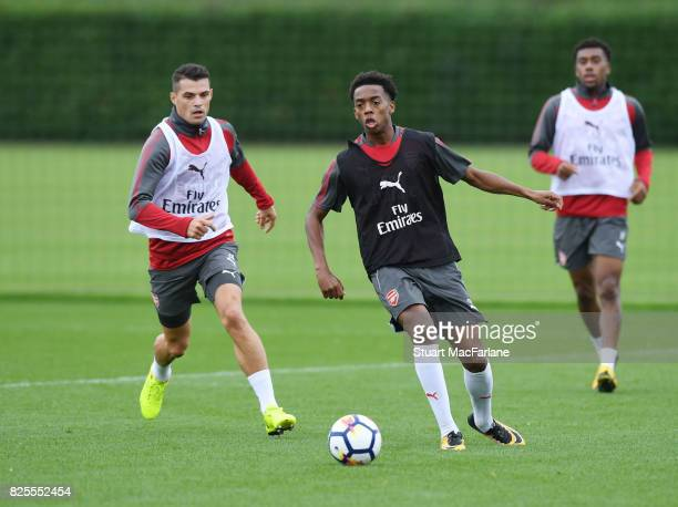 Granit Xhaka and Joe Willock of Arsenal during a training session at London Colney on August 2 2017 in St Albans England