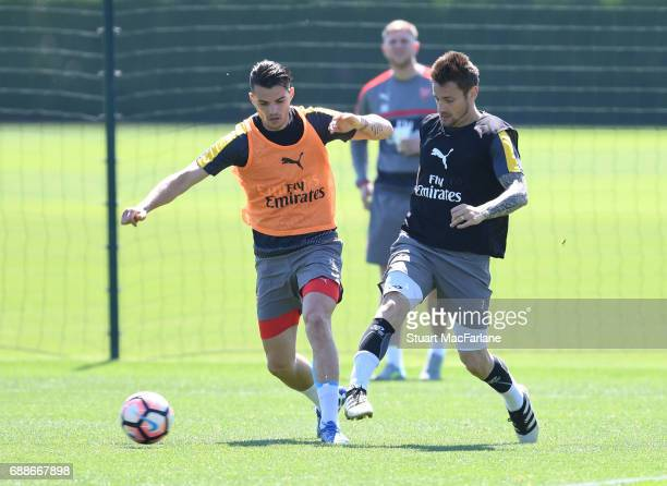 Granit Xhaka and Mathieu Debuchy of Arsenal during a training session at London Colney on May 26 2017 in St Albans England