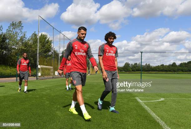 Granit Xhaka and Mohamed Elneny of Arsenal before a training session at London Colney on August 18 2017 in St Albans England